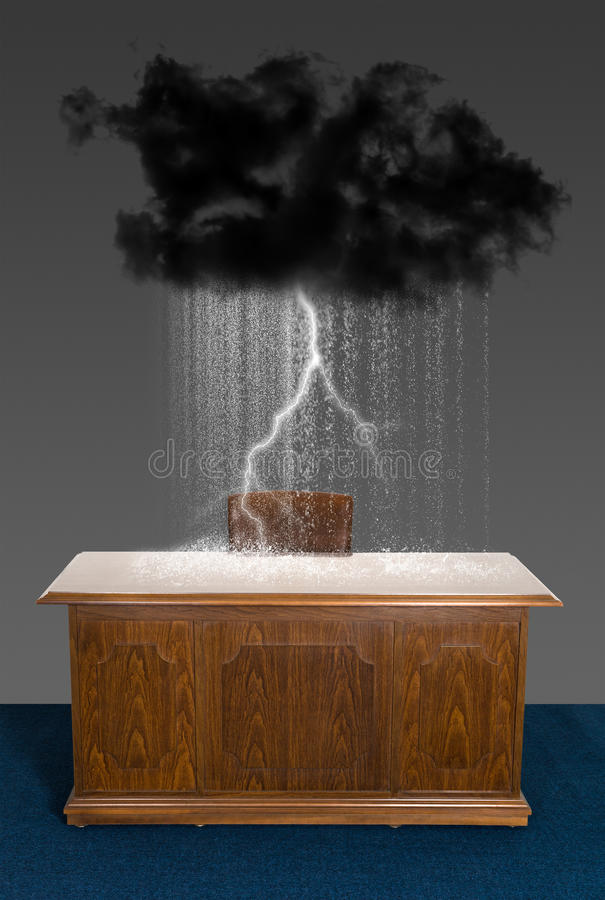 Rain Storm Cloud Business Office Desk. Thunder, lighting, and rain are delivered by a rain storm cloud over a business office desk. Abstract concept for sales royalty free stock photography