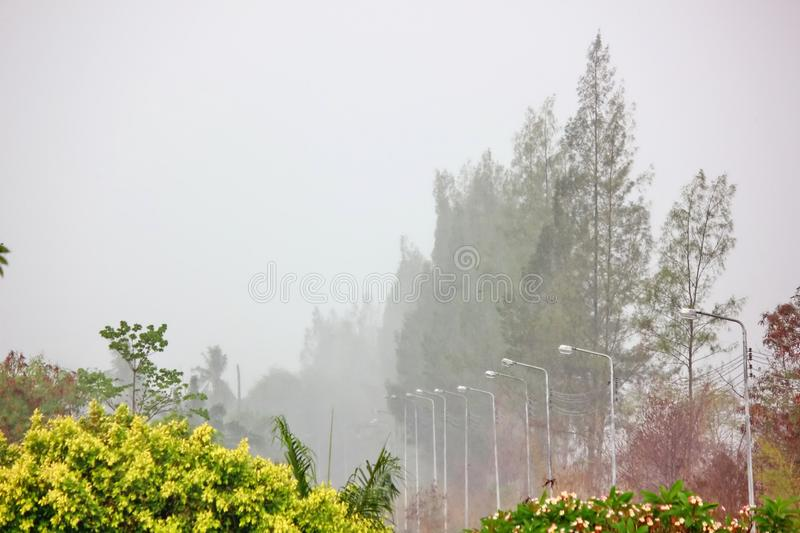 Rain storm with gray sky background. rain storms are blowing through farmland. Nature, dark, stormy, weather, cloudscape, grey, dramatic, cloudy, danger, moody royalty free stock images