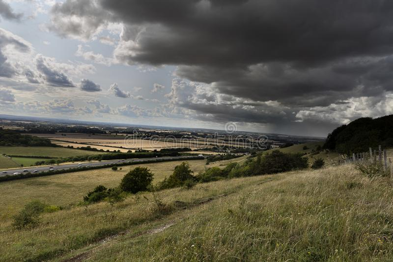 Rain storm over landscape highway in distamce royalty free stock photo