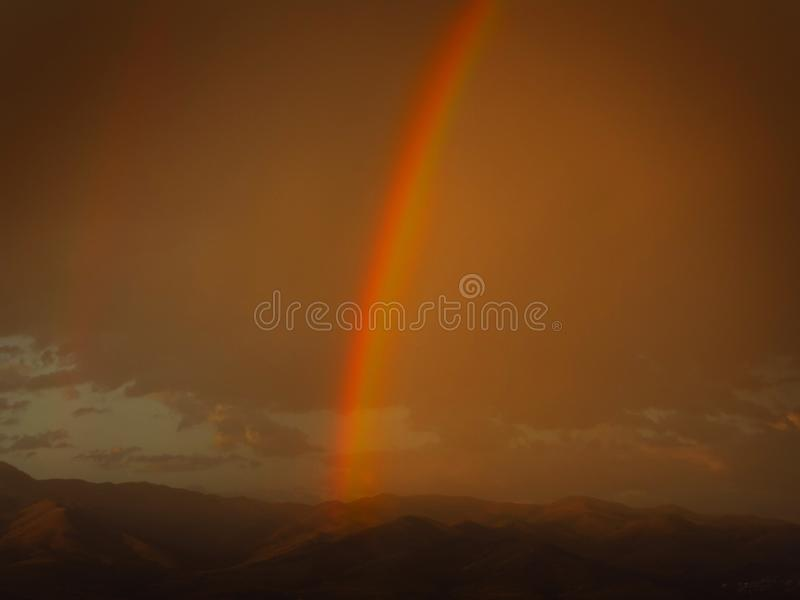 Rain Storm and Rainbow Clouds Over Mountains stock photos
