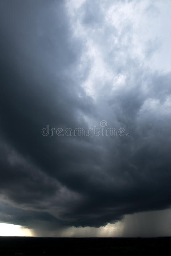 Rain Storm, Weather, Stormy Sky. Rain storm and stormy clouds in the sky make up this dramatic weather system as a warm and cold front meet to cause a downpour stock photography