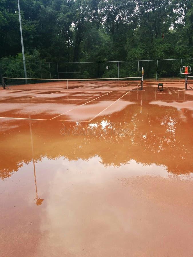 Rain on tenniscourt royalty free stock image
