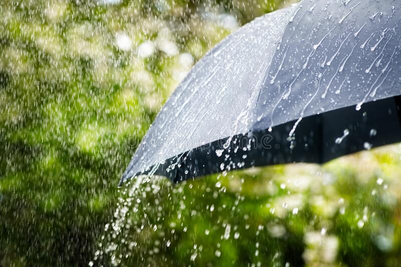Rain on umbrella concept for bad weather, winter or protection royalty free stock photography