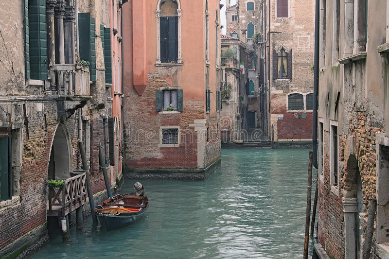 Rain in Venice. Narrow streets of Venice are very colorful. Wonderful city. Venice. Italy.  royalty free stock images