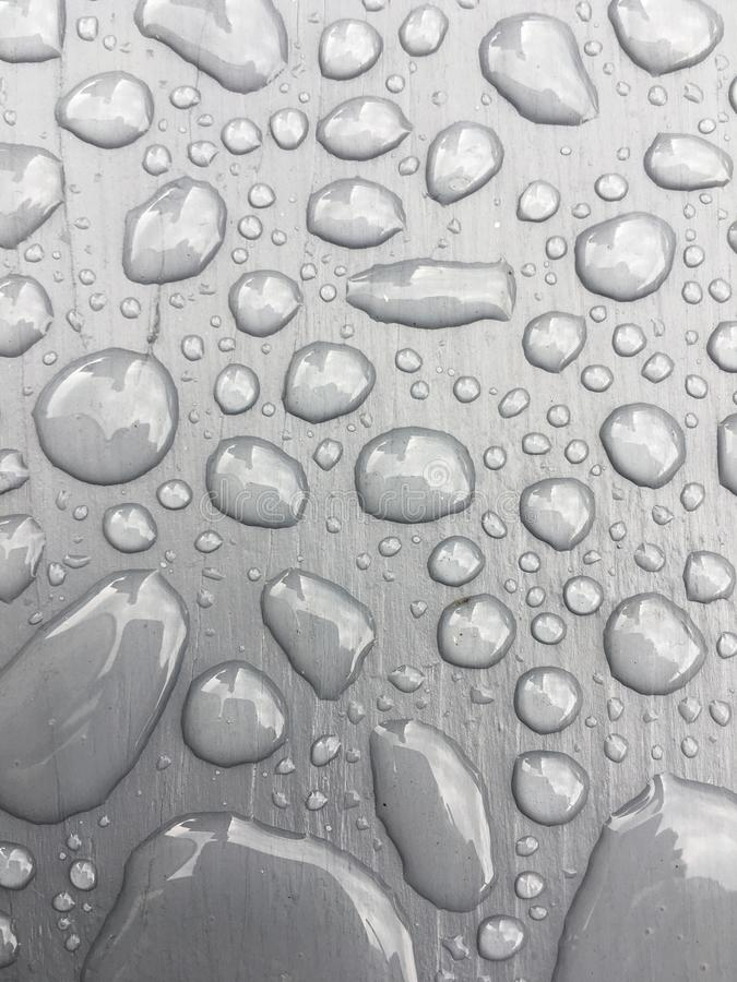 Rain water on grey background stock photography