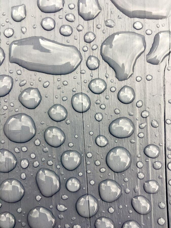 Rain water on grey background stock photos