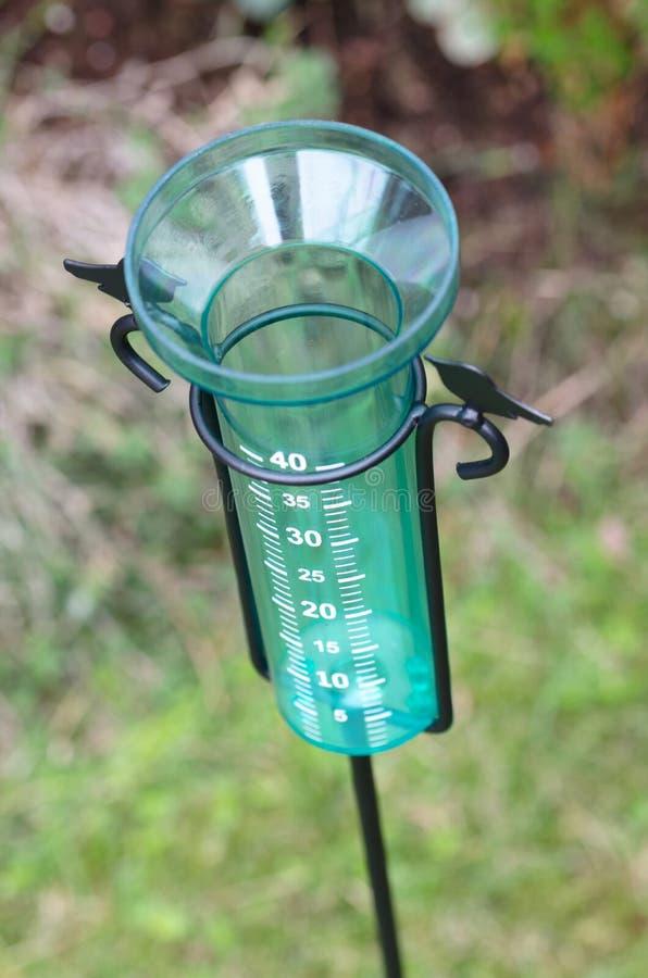 Rain water meter. In the garden stock photos