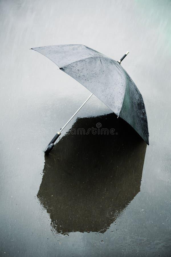 Rain and wet umbrella stock images