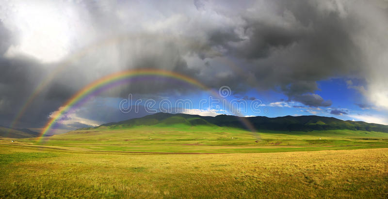 Rainbow. After the storm in the mountains of Almaty region national park Assy stock images