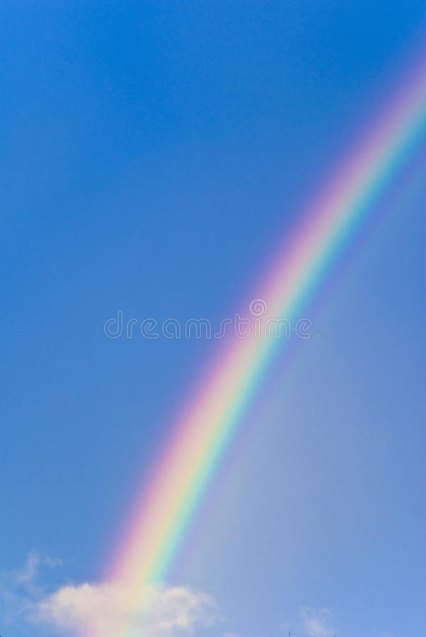 Rainbow. In the blue sky, photo of