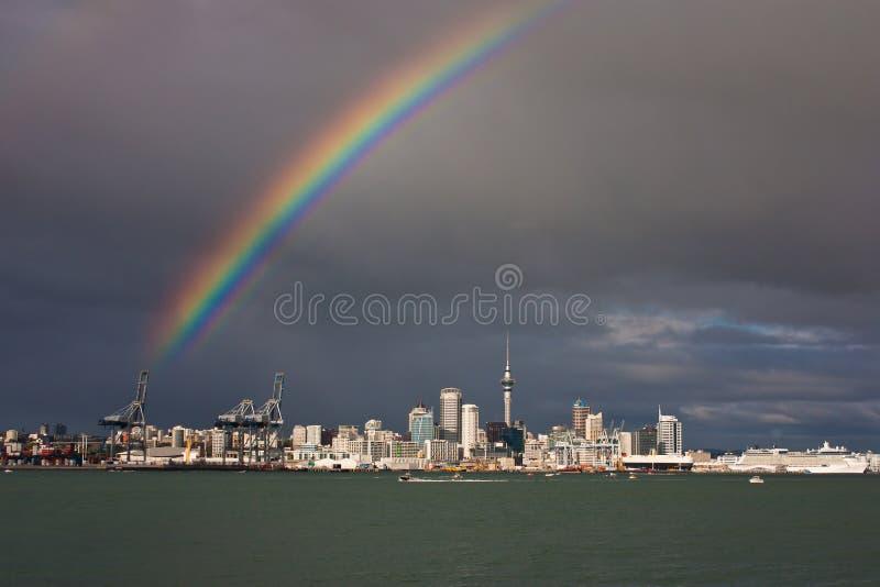Rainbow above Auckland city in New Zealand. Vacation in Oceania, zelandia adventure, modern city scape stock photo