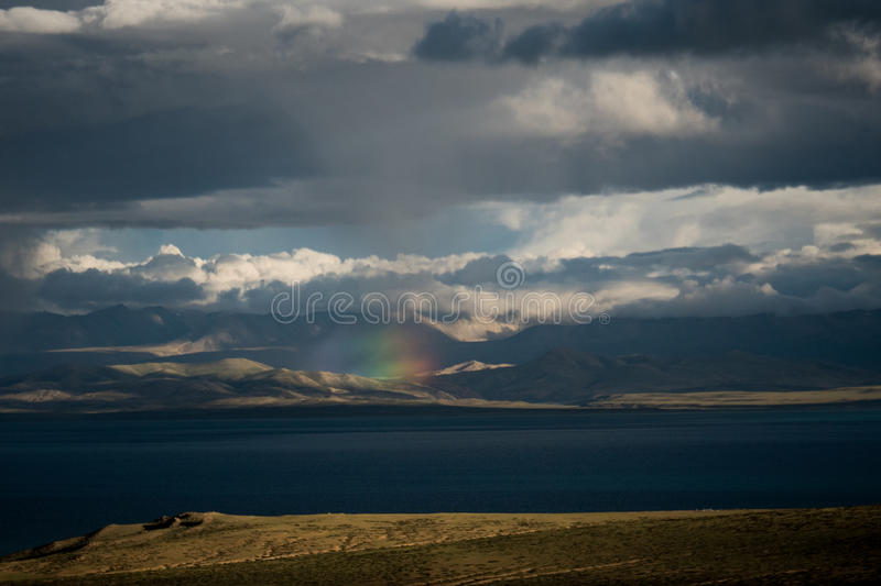 Rainbow above Mountain Lake Manasarovar Himalayas Tibet royalty free stock images