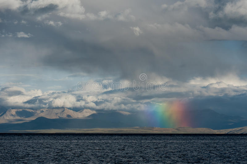 Rainbow above Mountain Lake Manasarovar Himalayas Tibet royalty free stock photo