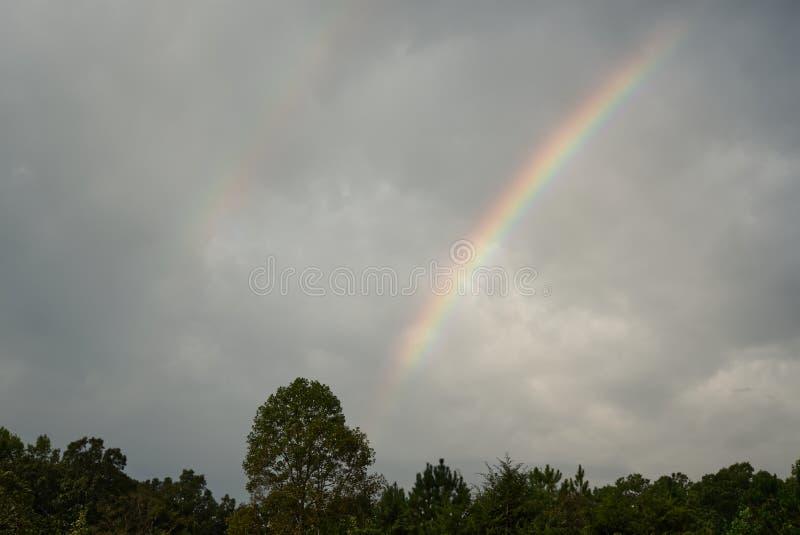 A rainbow against a dark sky. royalty free stock photo