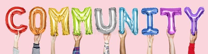 Rainbow alphabet balloons forming the word community stock photos