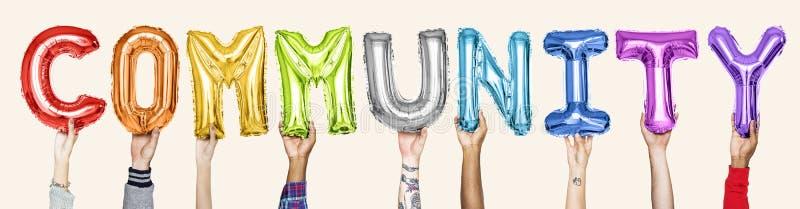 Rainbow alphabet balloons forming the word community stock image