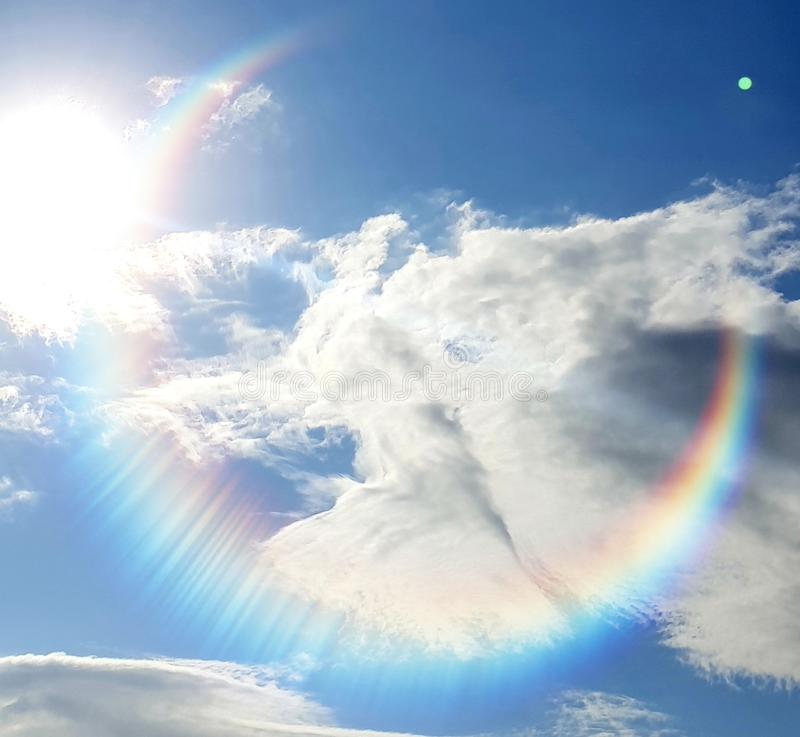 Rainbow angel. Angelic clouds with Rainbow, photographed at Uvongo, South Africa stock photos