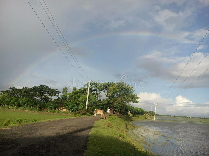 Rainbow. Area of tropic of cancer rain comes before making a beautiful rainbow stock photos