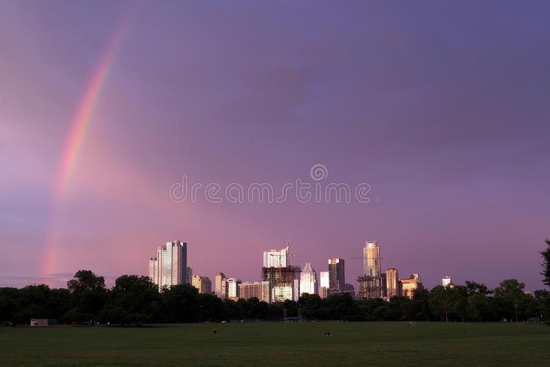 A rainbow Austin Texas skyline, June 2015. A rainbow begins it's stretch over Austin, Texas. View from Zilker Park of ATX skyline after a rainshower stock photography