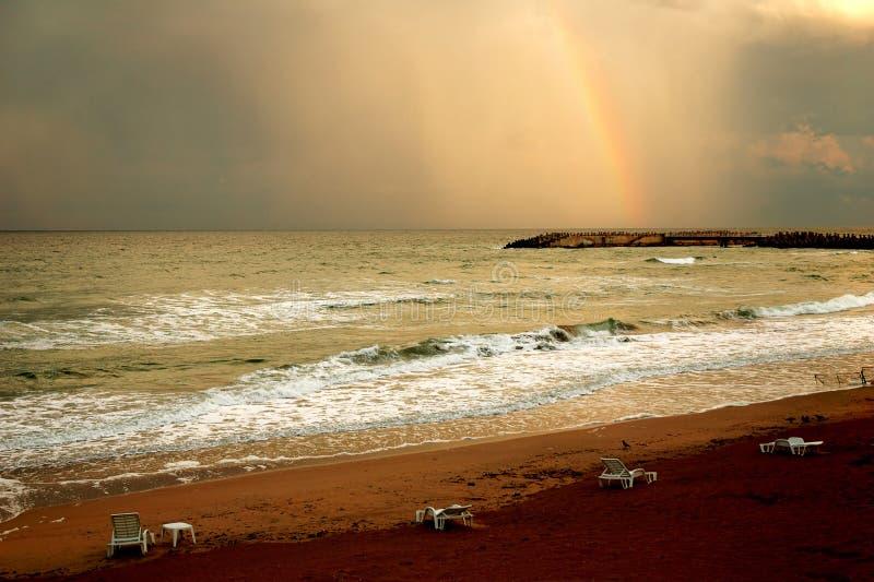 Rainbow on beach royalty free stock photos