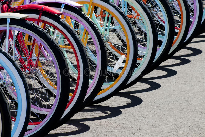 Rainbow of bike wheels. Colorful bike wheel parked to make a pattern royalty free stock photography