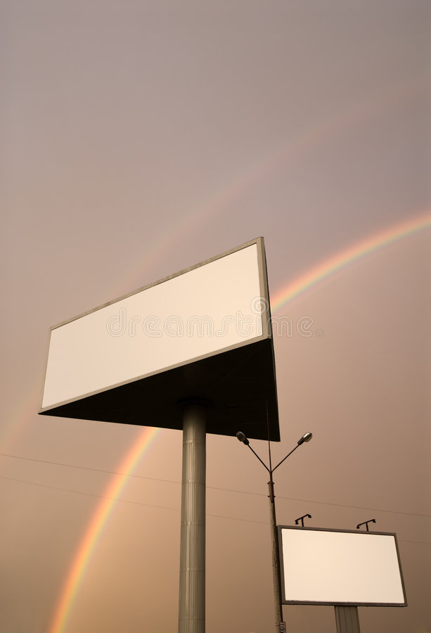 Rainbow billboards. Two blank billboards under double rainbow royalty free stock image