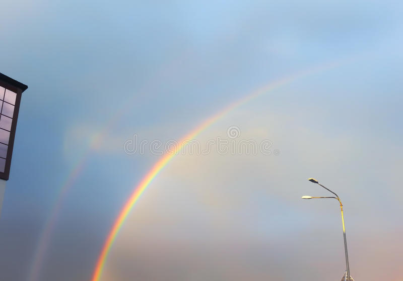 Rainbow In The Blue Sky stock photography