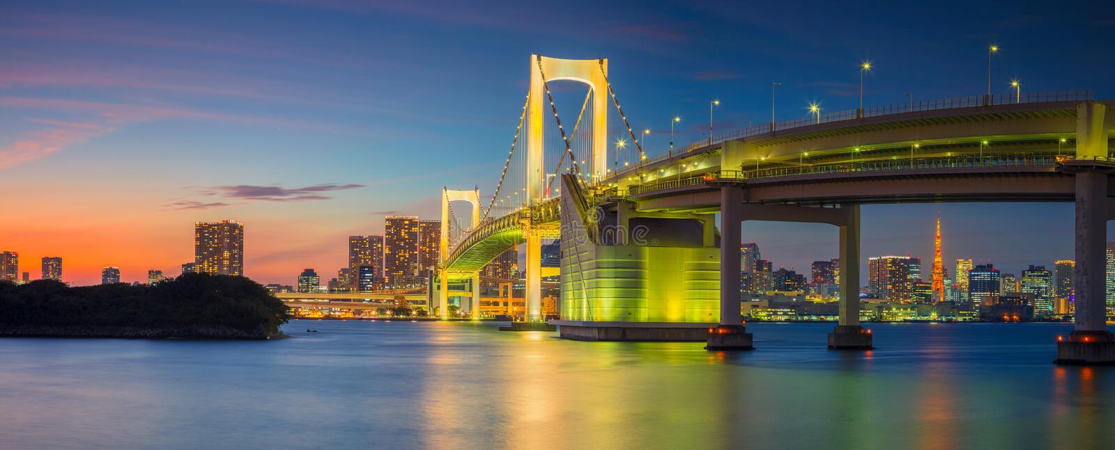 Rainbow Bridge Panorama in Tokyo. Panoramic cityscape image of Tokyo, Japan with Rainbow Bridge during sunset stock images