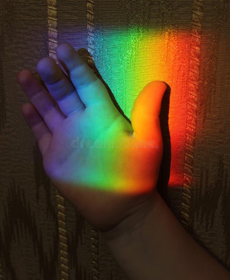 Rainbow on the child hand stock photo