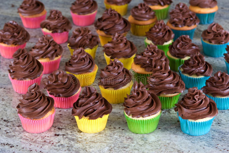 Download Rainbow Of Choclate Frosted Cupcakes Stock Photo - Image: 23036166