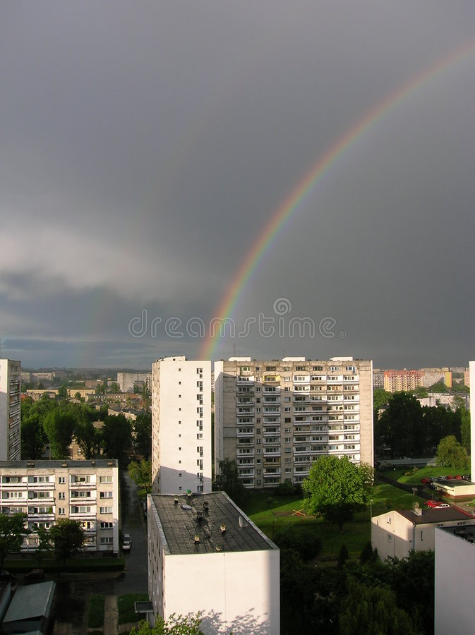 Rainbow in the city royalty free stock photo