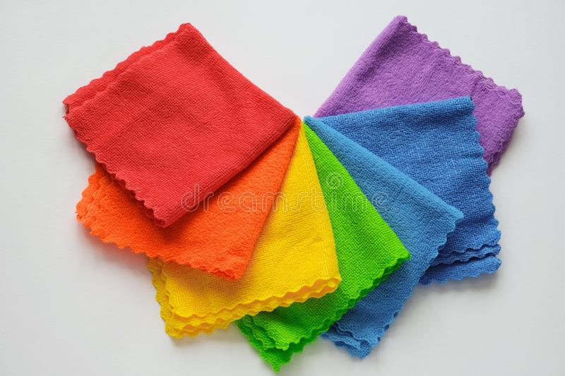 rainbow cloth patterns on white background, red, orange, yellow, green, blue and purple rags top view stock image