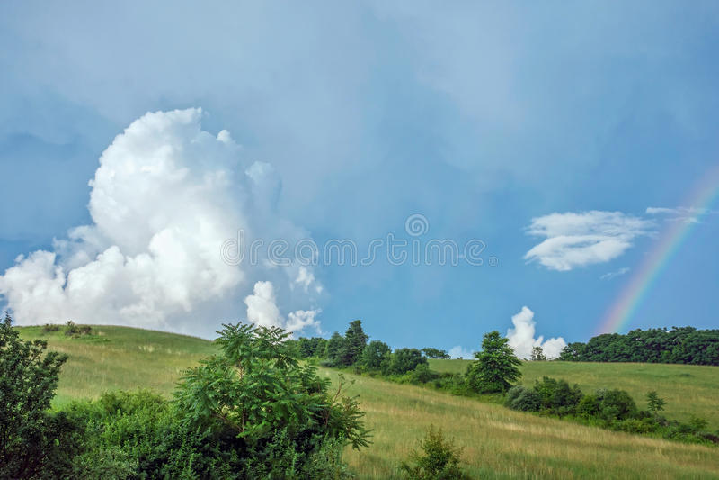 Rainbow and Cloud stock image