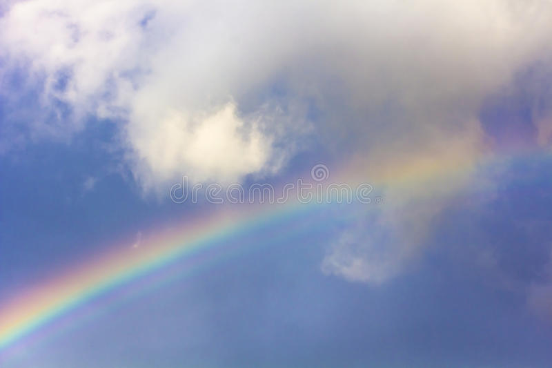 Rainbow among clouds in the sky.Background.Soft focus.  stock image