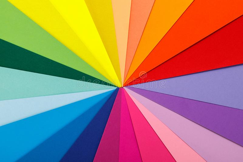 Rainbow color palette. Sheets of colored paper stock photos