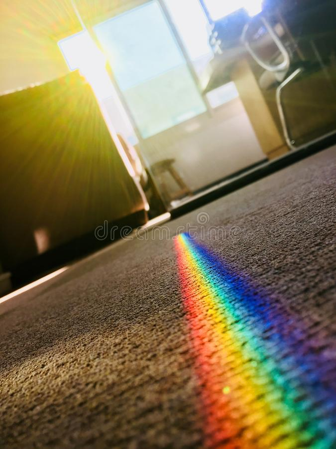 Rainbow Color Patch on Area Rug stock photos