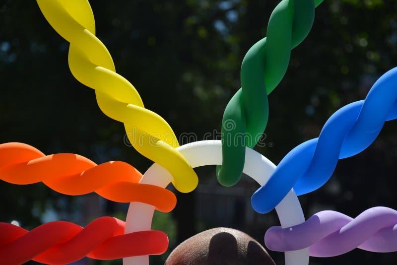 Rainbow Colored Balloon Hat in Portland, Oregon stock photo