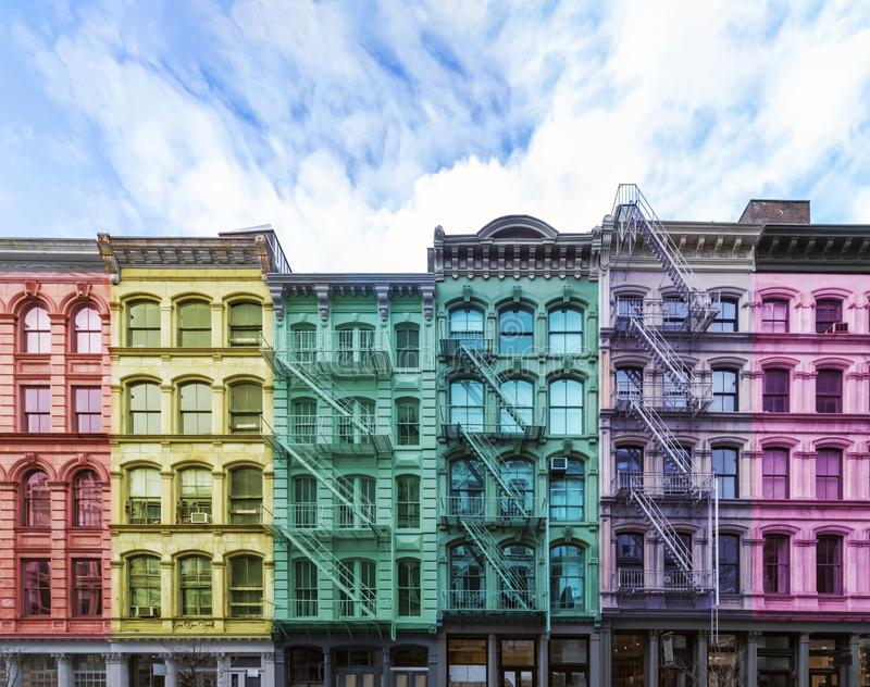 Rainbow colored block of old buildings in SoHo York City. Rainbow colored block of old buildings in the SoHo neighborhood of Manhattan in New York City with blue stock image