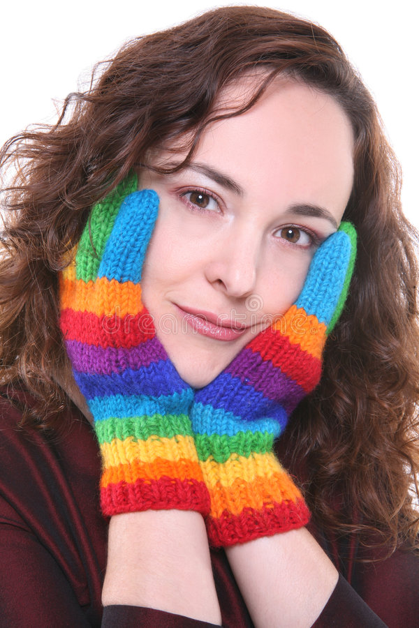 Rainbow colored knitted gloves stock photos