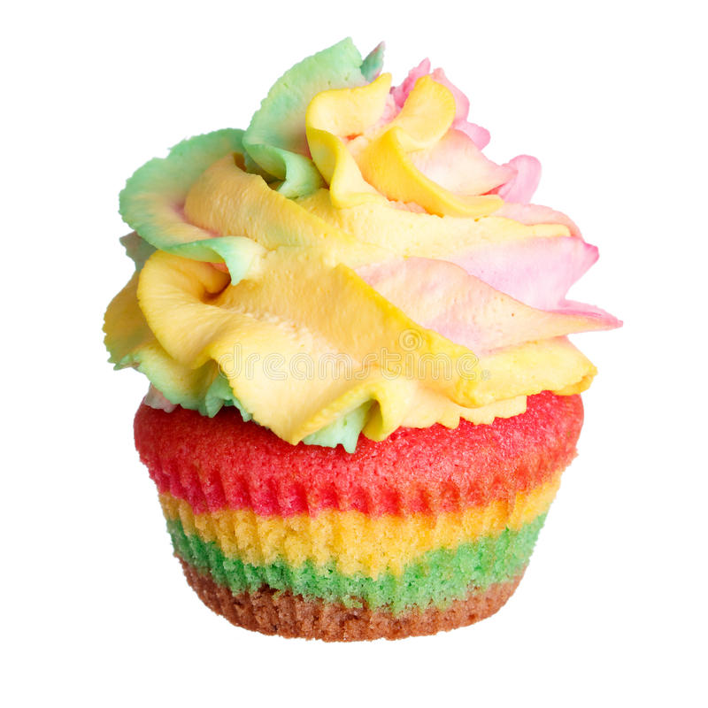 Rainbow colored muffin isolated on white royalty free stock images