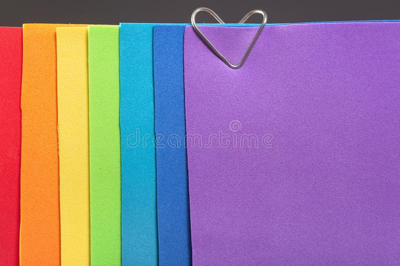 A rainbow colored note paper with a heart clip. The concept of love and Valentine`s Day for same-sex couples stock photos