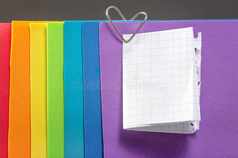 A rainbow colored note paper with a heart clip. The concept of love and Valentine`s Day for same-sex couples stock photo
