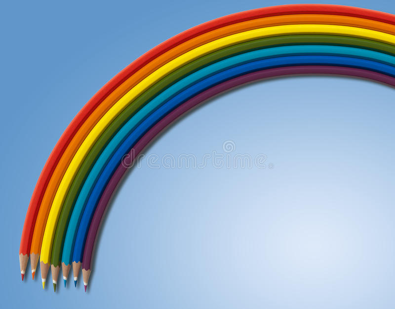 Rainbow from colored pencils on blue. Rectangle royalty free stock photos