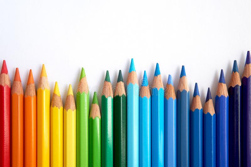 Rainbow colored pencils are jiggling side by side. stock photography
