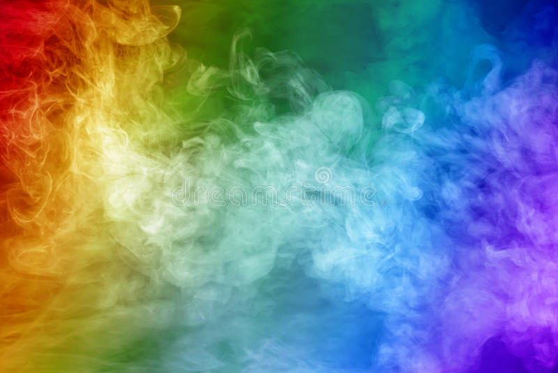 Rainbow colored smoke stock photos
