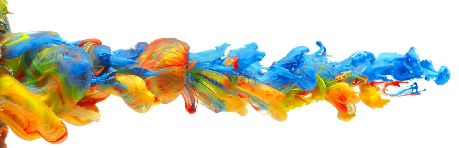 Rainbow of colorful paints and inks together in flowing water abstract background royalty free stock images