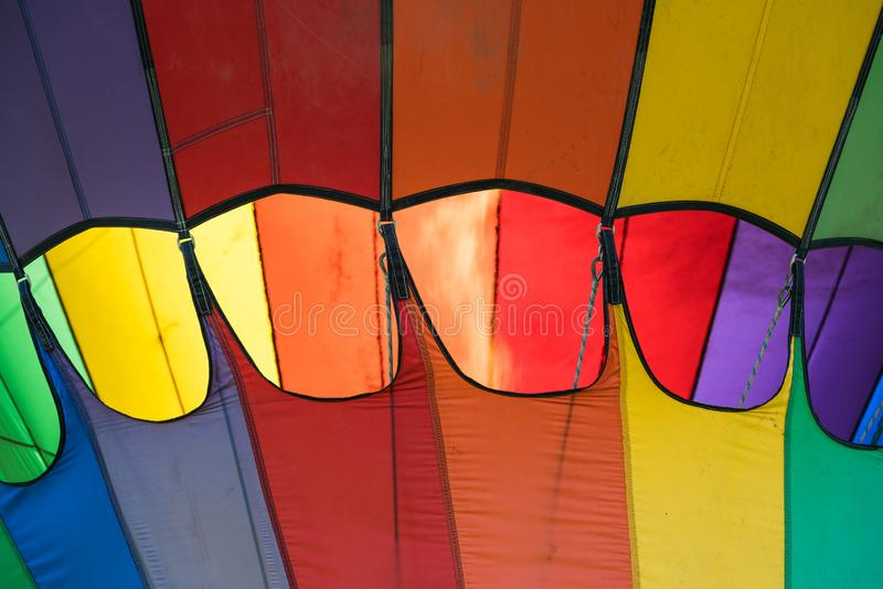 The rainbow colors and fire. This is a photograph of the fire and rainbow colors of a hot air balloon stock images