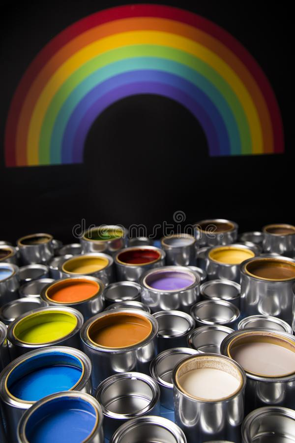 Rainbow colors, Group of tin metal cans. Rainbow, tin metal cans with color paint stock image