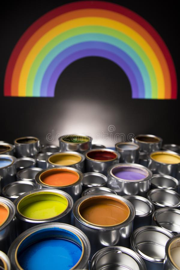 Rainbow colors, Group of tin metal cans. Rainbow, tin metal cans with color paint royalty free stock photo