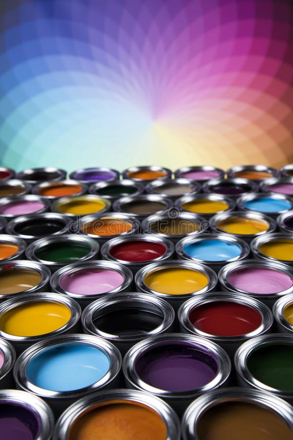 Creativity concept group of tin metal cans with color paint royalty free stock images